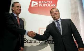 José María Arias y Ángel Ron tras el acuerdo que permitió a Banco Popular absorber a Banco Pastor