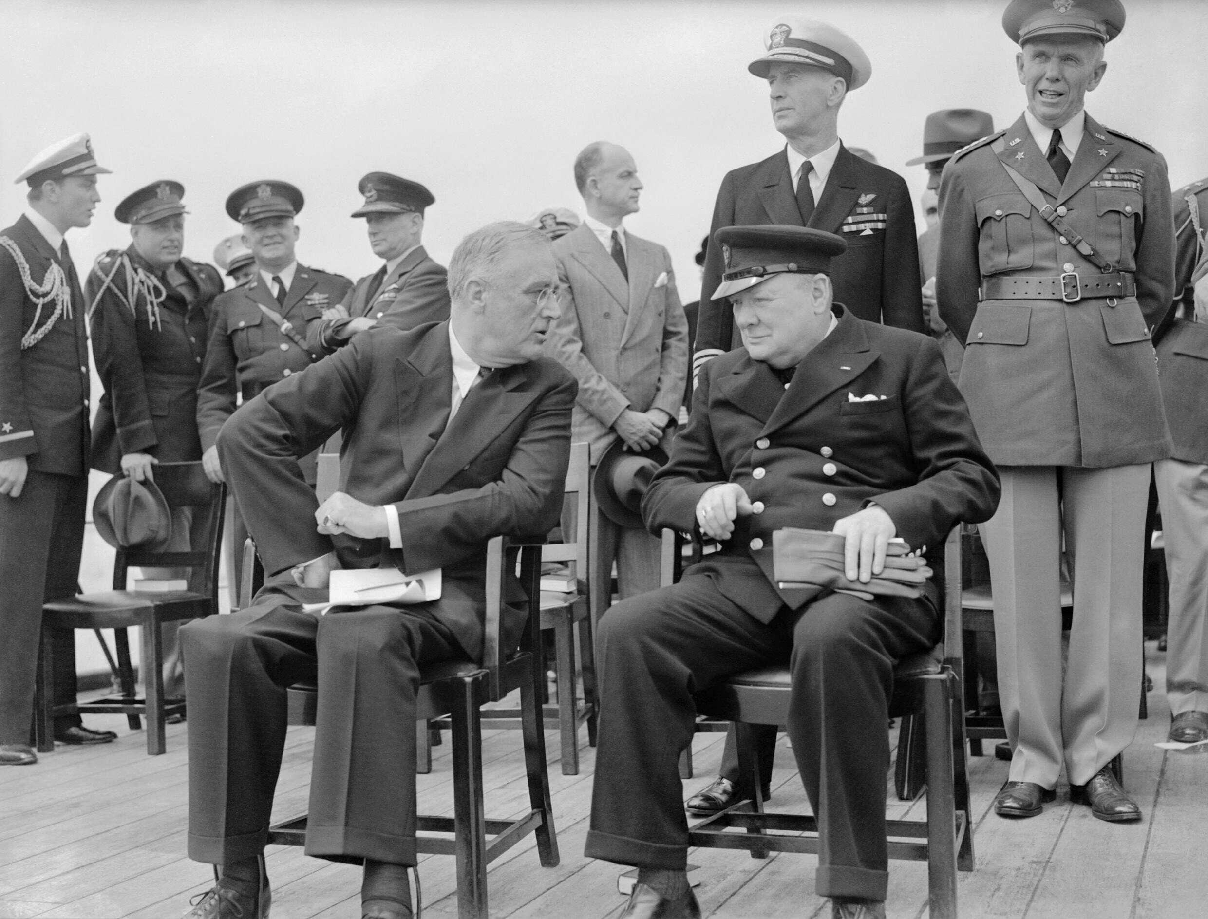 president roosevelt and winston churchill seated on the quarterdeck of hms princ