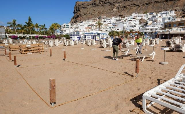 Playas parceladas Foto AÌngel Medina   EFE